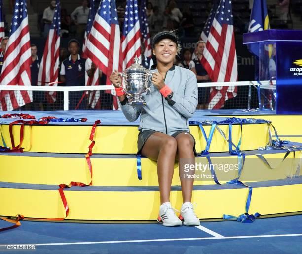 Naomi Osaka of Japan women's single final winner of US Open 2018 poses with trophy at USTA Billie Jean King National Tennis Center