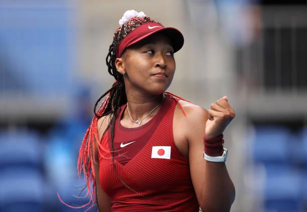 Naomi Osaka of Team Japan celebrates after match point in her Women's Singles Second Round match against Viktorija Golubic of Team Switzerland on day...