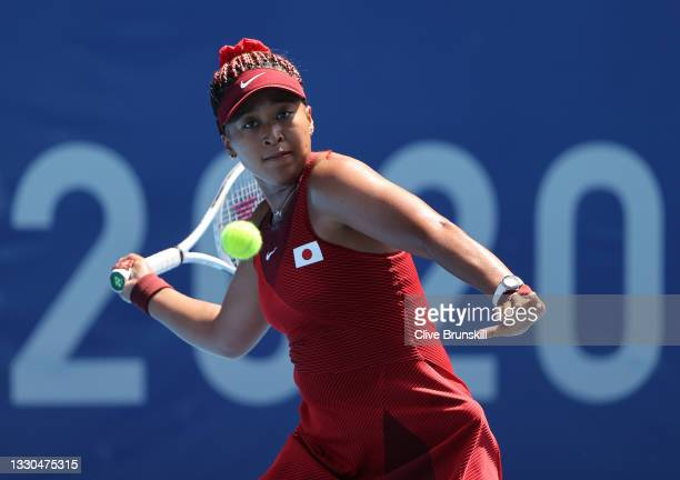 Naomi Osaka of Team Japan plays a forehand during her Women's Singles First Round match against Saisai Zheng of Team China on day two of the Tokyo...