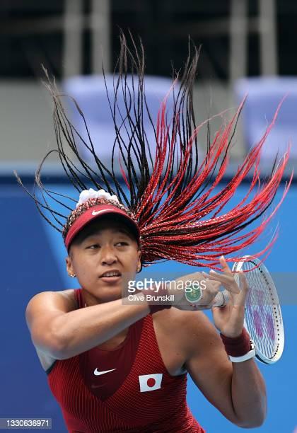 Naomi Osaka of Team Japan plays a forehand during her Women's Singles Second Round match against Viktorija Golubic of Team Switzerland on day three...