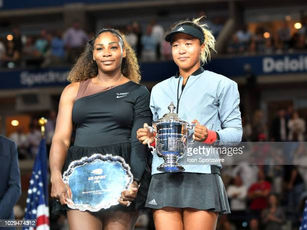 Naomi Osaka poses with the trophy after defeating Serena Williams in the final of the Women's Singles Championships at the US Open on September 08...