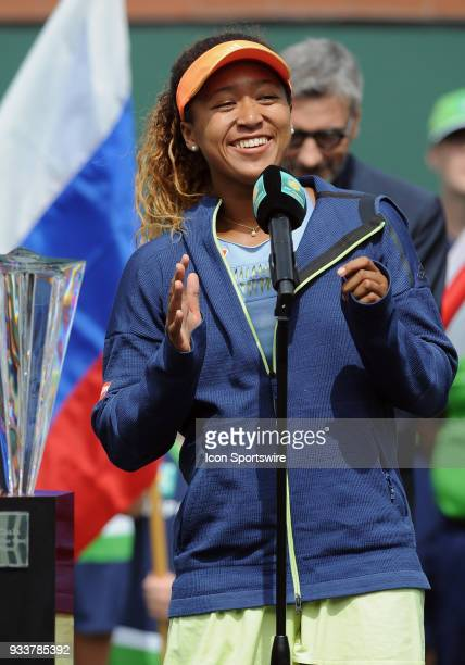 Naomi Osaka talks to the fans while standing next to the winners trophy after defeating Daria Kasatkina to become the 2018 BNP Paribas Open Champion...