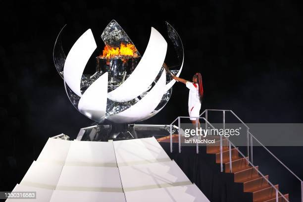 Naomi Oska lights the Olympic flame during the Opening Ceremony of the Tokyo 2020 Olympic Games at Olympic Stadium on July 23, 2021 in Tokyo, Japan.