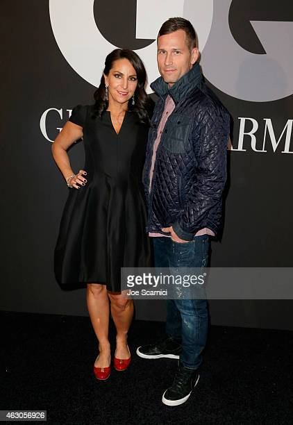 Naomi Raddon and DJ Kaskade attend GQ and Giorgio Armani Grammys After Party at Hollywood Athletic Club on February 8 2015 in Hollywood California