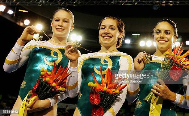 Naomi Russell Chloe Sims and Monette Russo of Australia celebrate winning Gold in the Womens Artistic Gymnastics at the Rod Laver Arena during day...
