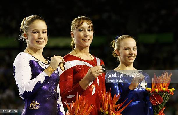 Naomi Russell of Australia Imogen Cairns of England and Alyssa Brown of Canada pose after receiving their medals during the Artistic Gymnastics...