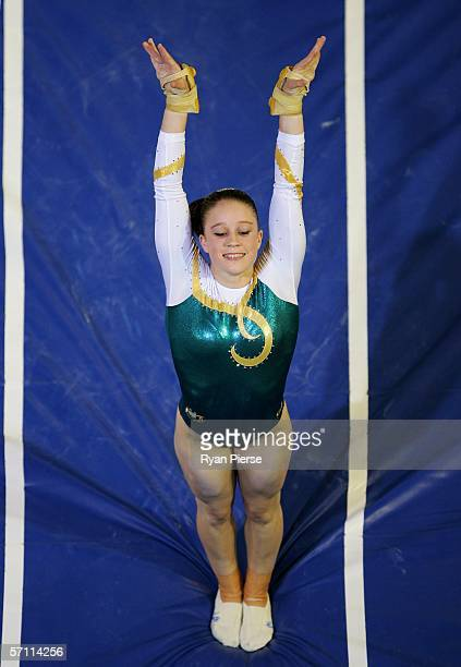 Naomi Russell of Australia lands after her performance on the Valut during the Womens Team competition in the Artistic Gymnastics at the Rod Laver...