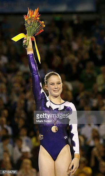 Naomi Russell of Australia waves to the crowd after receiving her Bronze medal during the Artistic Gymnastics Women's Vault competition at the Rod...