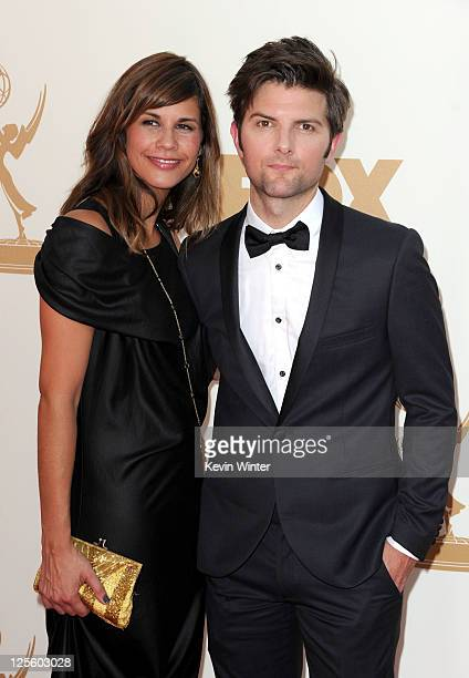 Naomi Sablan and actor Adam Scott arrives at the 63rd Annual Primetime Emmy Awards held at Nokia Theatre LA LIVE on September 18 2011 in Los Angeles...