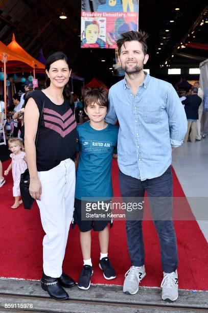 Naomi Scott Adam Scott and son at PS ARTS' Express Yourself 2017 at Barker Hangar on October 8 2017 in Santa Monica California