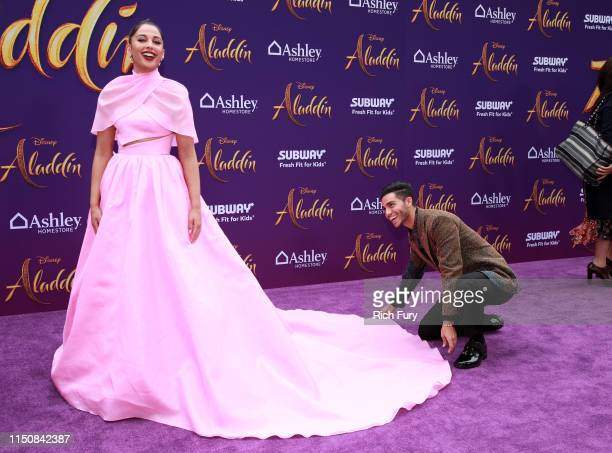 Naomi Scott and Mena Massoud attend the premiere of Disney's Aladdin on May 21 2019 in Los Angeles California