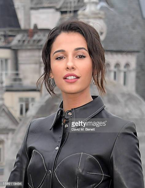 "Naomi Scott attends a photocall for ""Charlie's Angels"" at The Corinthia Hotel London on November 21, 2019 in London, England."