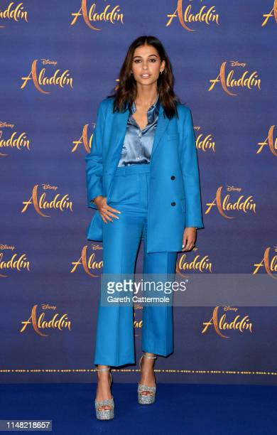 """Naomi Scott attends the photocall to celebrate release of Disney's """"Aladdin"""" at The Rosewood Hotel on May 10, 2019 in London, England."""