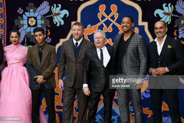 Naomi Scott Mena Massoud Guy Ritchie Alan Menken Will Smith and Navid Negahban attend the premiere of Disney's Aladdin at El Capitan Theatre on May...