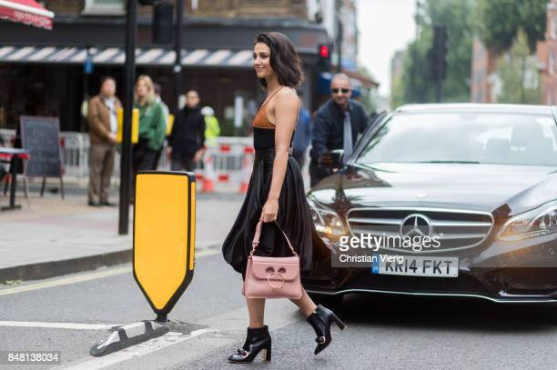 Naomi Scott outside JW Anderson during London Fashion Week September 2017 on September 16, 2017 in London, England.