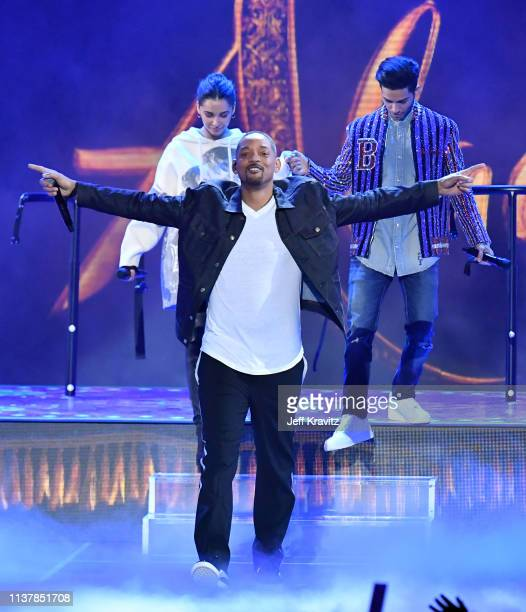 Naomi Scott Will Smith and Mena Massoud perform onstage at Nickelodeon's 2019 Kids' Choice Awards at Galen Center on March 23 2019 in Los Angeles...