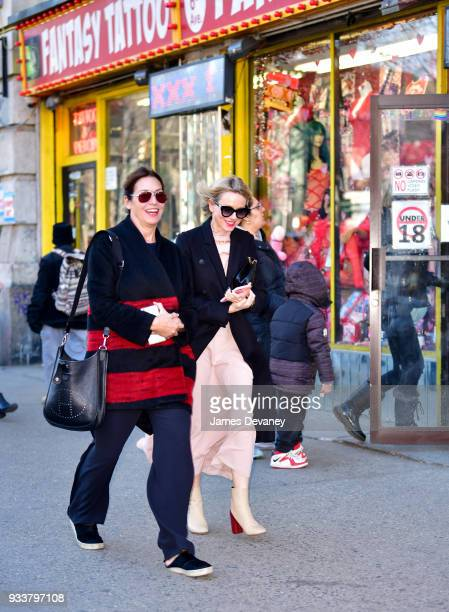 Naomi Watts and friend share a laugh while walking past Fantasy Party adult store on March 18 2018 in New York City