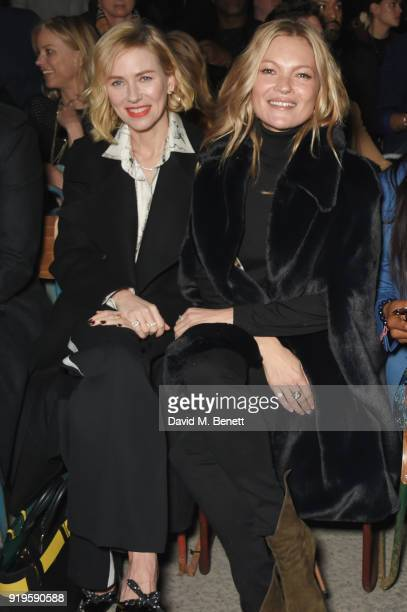 Naomi Watts and Kate Moss wearing Burberry at the Burberry February 2018 show during London Fashion Week at Dimco Buildings on February 17 2018 in...