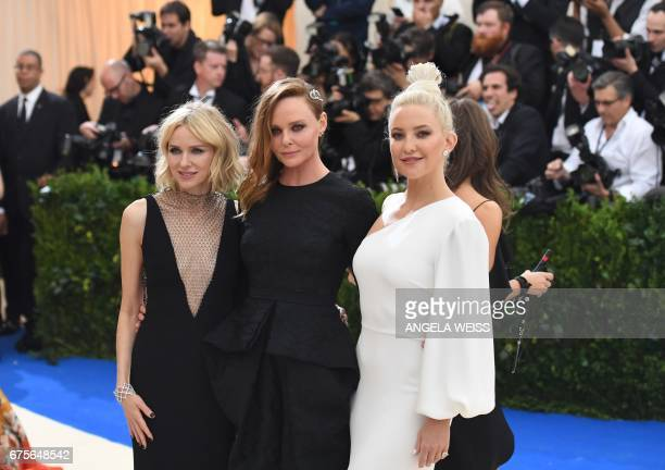 Naomi Watts Stella McCartney and Kate Hudson attend the Costume Institute Benefit on May 1 2017 at the Metropolitan Museum of Art in New York / AFP...