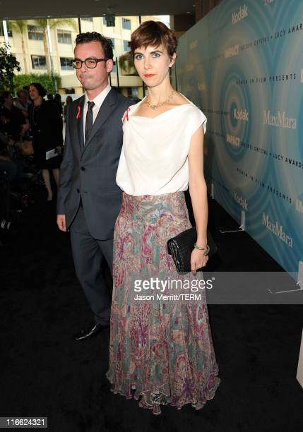 Naomi Wilding and guest arrive at the 2011 Women In Film Crystal Lucy Awards with presenting sponsor PANDORA jewelry at the Beverly Hilton Hotel on...