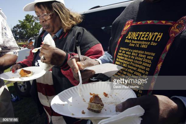 Naomi Williams and D'Emanuel Grosse Sr taste the sweet potato pie entered in the cookoff contest at the Juneteenth Black Independence Day...