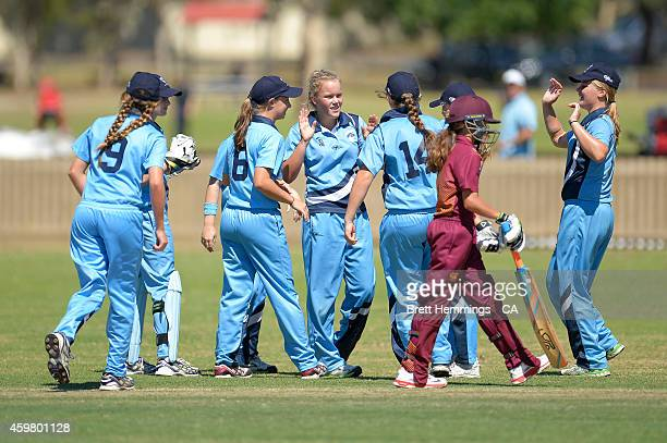 Naomi Woods of NSW Metropolitan celebrates taking the wicket of Charli Knott of Queensland during the Under 15 female championship match between NSW...