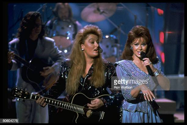 Naomi Wynonna Judd of motherdaughter C/W duo The Judds performing onstage on NBC TV show Hot Country Nights