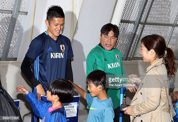 Naomichi Ueda and head coach Makoto Teguramori of Japan U23 attend a donation sesseion for the earthquakes victims in Kumamoto after a training...
