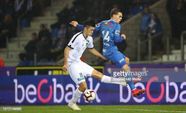 Naomichi Ueda and Leandro Trossard fight for the ball during the Jupiler Pro League match between KRC Genk and Cercle Brugge KSV at Cristal Arena on...