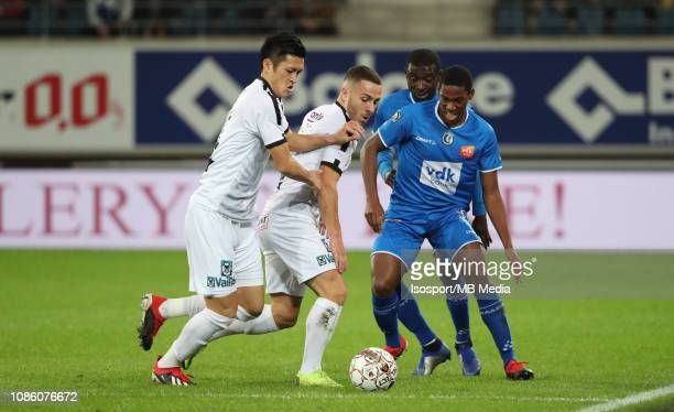 Naomichi Ueda of Cercle Kylian Hazard of Cercle and JeanLuc Dompe of Kaa Gent fight for the ball during the Jupiler Pro League match between KAA Gent...