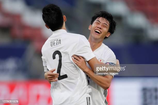 Naomichi Ueda of Japan celebrates 1-0 with Wataru Endo of Japan during the International Friendly match between Japan v Ivory Coast at the Stadium...