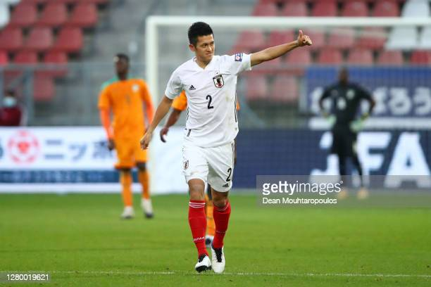 Naomichi Ueda of Japan celebrates after scoring his team's first goal during the international friendly match between Japan and Ivory Coast at...