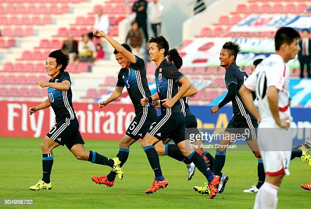 Naomichi Ueda of Japan celebrates scoring his team's first goal during the AFC U23 Championship Group B match between Japan and North Korea at Grand...
