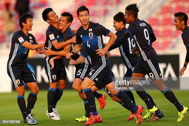 Naomichi Ueda of Japan celebrates with his teammates after scoring the opening goal during the AFC U23 Championship Group B match between Japan and...