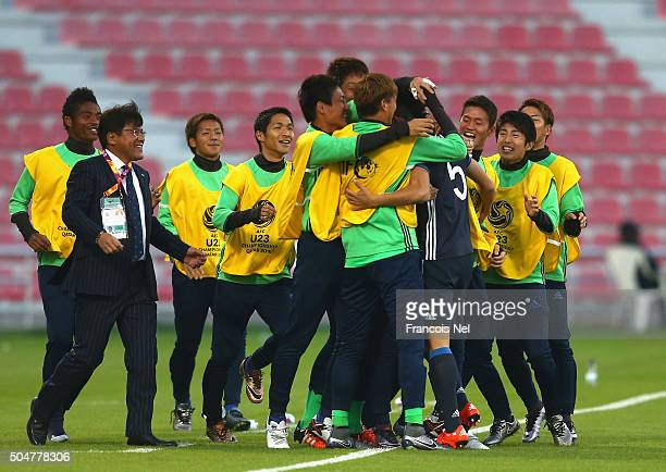 Naomichi Ueda of Japan celebrates with his teammates and Makoto Teguramori Head coach of Japan after scoring the opening goal during the AFC U23...