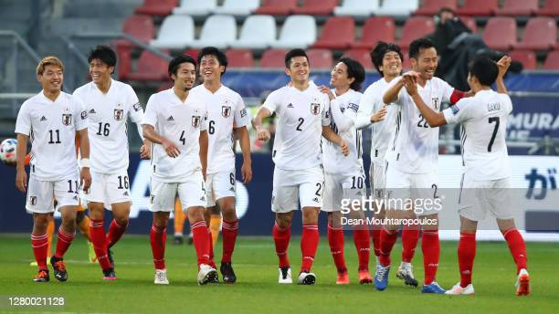 Naomichi Ueda of Japan celebrates with team mates after scoring the winning goal during the international friendly match between Japan and Ivory...