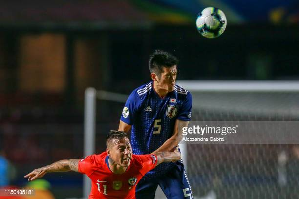 Naomichi Ueda of Japan heads for the ball against Eduardo Vargas of Chile during the Copa America Brazil 2019 group C match between Japan and Chile...
