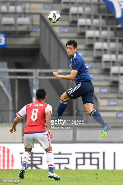 Naomichi Ueda of Japan heads the ball during the international friendly match between Japan and Paraguay at Tivoli Stadion on June 12 2018 in...