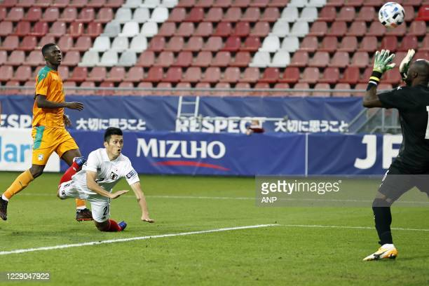 Naomichi Ueda of Japan scores the 1-0 during the friendly match between Japan and Ivory Coast at Stadium Galgenwaard on October 13, 2020 in Utrecht,...