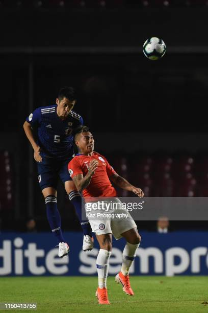 Naomichi Ueda of Japan wins the header over Gary Alexis Medel Soto of Chile during the Copa America Brazil 2019 group C match between Japan and Chile...