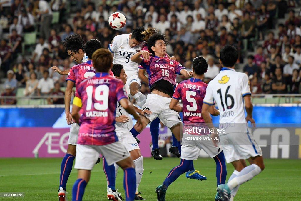 Naomichi Ueda of Kashima Antlers and Hideto Takahashi of Vissel Kobe compete for the ball during the J.League J1 match between Vissel Kobe and Kashima Antlers at Noevir Stadium Kobe on August 9, 2017 in Kobe, Hyogo, Japan.