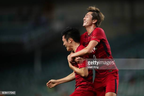 Naomichi Ueda of Kashima Antlers celebrates with Yuma Suzuki of Kashima Antlers after scoring a goal during the AFC Asian Champions League match...