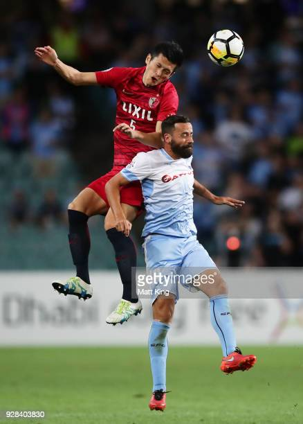 Naomichi Ueda of Kashima Antlers competes for the ball against Alex Brosque of Sydney FC during the AFC Asian Champions League match between Sydney...