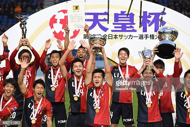 Naomichi Ueda of Kashima Antlers lifts the Cup after the 96th Emperor's Cup final match between Kashima Antlers and Kawasaki Frontale at Suita City...