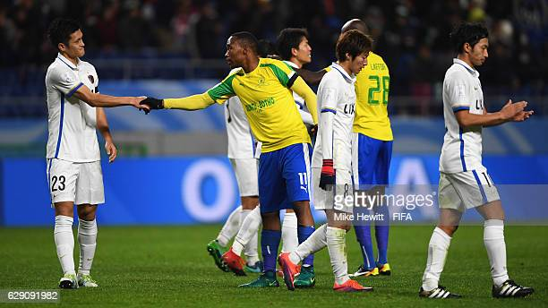 Naomichi Ueda of Kashima Antlers shakes hands with Sibusiso Vilakazi of Mamelodi Sundowns after the FIFA Club World Cup second round match between...