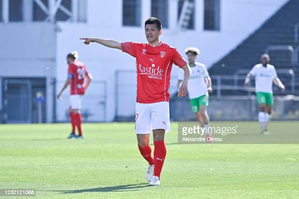 Naomichi UEDA of Nimes during the Ligue 1 match between Nimes Olympique and AS Saint-Etienne at Stade des Costieres on April 4, 2021 in Nimes, France.