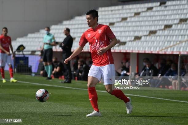 Naomichi UEDA of Nimes during the Ligue 1 match between Nimes Olympique and Montpellier HSC at Stade des Costieres on March 14, 2021 in Nimes, France.
