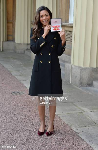 Naomie Harris after receiving her OBE medal from Queen Elizabeth II at Buckingham Palace on February 23 2017 in London England