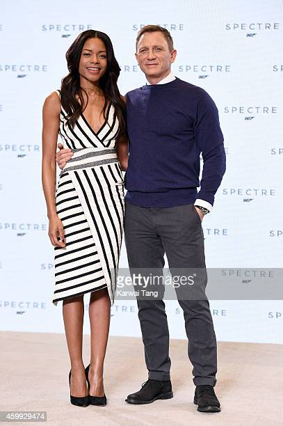 Naomie Harris and Daniel Craig attend the photocall to announce the start of the production of the 24th Bond Film 'Spectre' at Pinewood Studios on...