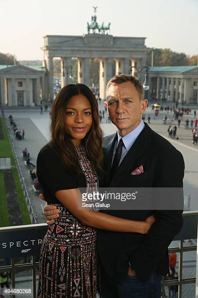 Naomie Harris and Daniel Craig pose with the Brandenburg Gate behind during a photocall prior the German premiere of the new James Bond movie...